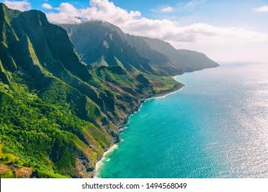 Hawaii Kauai lansdcape aerial view from the air helicopter flight. Amazing dramatic Na Pali coast of hawaiian island mountains, USA summer travel.