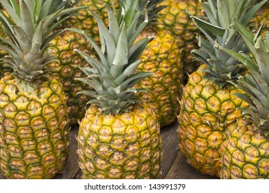 Hawaii, Oahu, Pineapples for sale at a local roadside fruit stand on the North Shore.