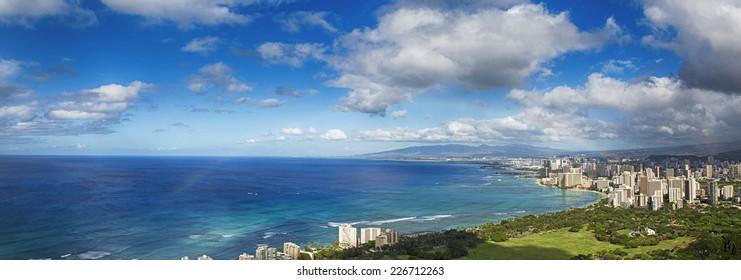 Hawaii panoramic with rainbow over the city skyline