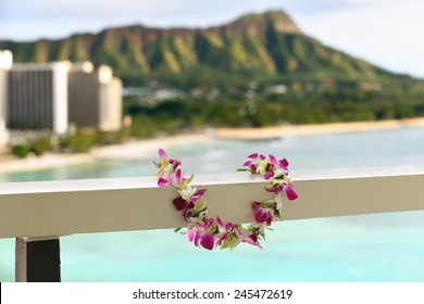 Hawaii travel icon: Lei flower necklace in front of Waikiki beach and Diamond Head state monument in Honolulu