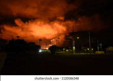 Pahōa, Hawaii, USA. The glowing of new lava flow from fissure 8 at night in the town of Pahōa. Kilauea Volcano.