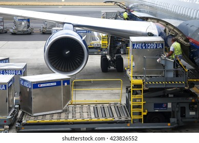 Hawaii, USA - May 19, 2008:airport personnel perform loading platform of air freight to the aircraft of Hawaii
