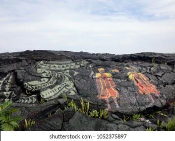 Hawaiian cultural folklore painted symbols on black lava rock