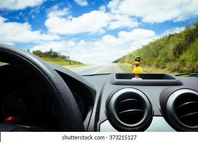 Hawaiian dancer doll in the car panel