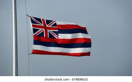 Hawaiian flag on pole