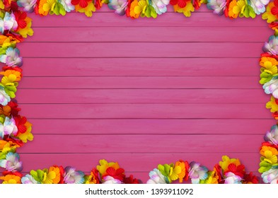 Hawaiian flowers on planks background