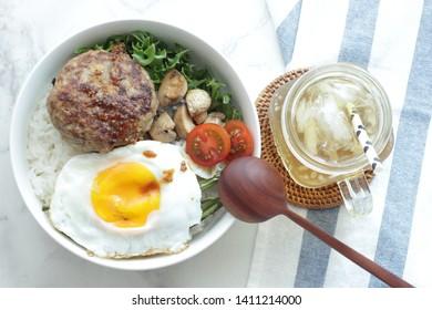 Hawaiian food, hamburger steak and sunny side up egg