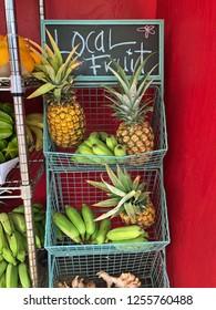 Hawaiian Fruit Market: pineapples, bananas, papayas, and ginger root