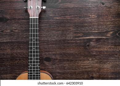 Hawaiian guitar - Ukulele, guitar neck on the wooden table