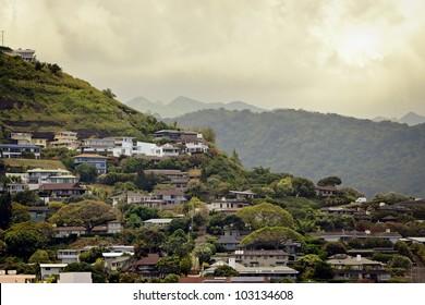 Hawaiian homes on a lush tropical hillside.