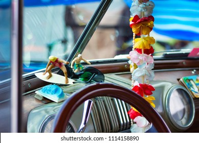 Hawaiian Lei in a vintage Woody Car with Surfers and Sunglasses at a fun car show.