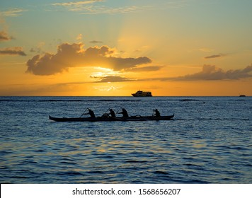 Hawaiian outrigger canoe with paddlers