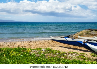 Hawaiian outrigger canoes on a beach in Maui, Hawaii