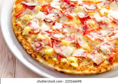 Hawaiian Pizza on wood table