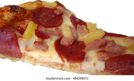 Hawaiian Pizza Slice Isolated Food - Delicious slice of pizza with pineapple, pepperoni, bacon and cheese isolated on a white background, tasty food photo.