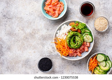 Hawaiian poke bowl with salmon, rice, avocado, carrot and cucumber