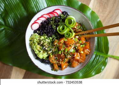 Hawaiian salmon poke with black forbidden rice, avocado, pickled cucumber and crispy kale