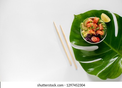 Hawaiian salmon poke bowl with cucumber, tomato, sesame seeds, avocado. Top view, flat lay, overhead,  Organic food. Buddha bowl. Diet.