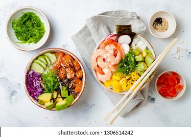 Hawaiian salmon and shrimp poke bowls with seaweed, avocado, mango, pickled ginger, sesame seeds. Top view, overhead, flat lay