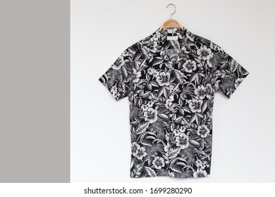 Hawaiian shirt  is clothes hanger on white background.