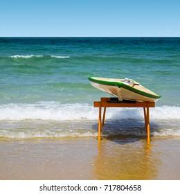 Hawaiian surfboard on the beach of the Mediterranean sea in Israel