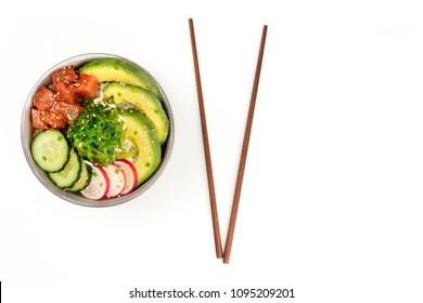 Hawaiian tuna poke salad on white, with wakame seaweed salad, chopsticks, and copy space