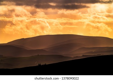 Hawick, Scottish Borders, UK. 7th January 2019. Clouds are blown across the hills of Liddesdale in the Scottish Borders, viewed from the Cross Borders Drove Road at Drinkstone.