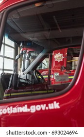 HAWICK, UK - 02 AUGUST 2017: British Fire Engines parked in a Fire Station ready for action
