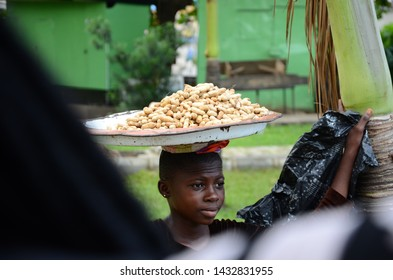 the hawkers. this boys and girl are hawking groundnut to make money for their parent in Lagos Nigeria. 23rd June 2019. Lagos Nigeria