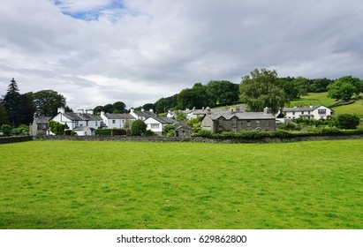 HAWKSHEAD, UNITED KINGDOM -25 JULY 2016- View of the traditional English village of Hawkshead in the Lake District in Cumbria, home to Hill Top, the farm house that once belonged to Beatrix Potter.