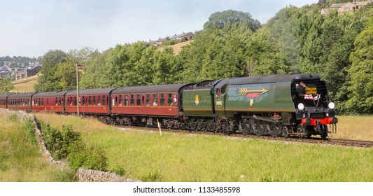 HAWORTH, ENGLAND, JUNE 25 2018 Former Southern Railway steam locomotive 34092 City of Wells leaving Haworth on The Keighley and Worth Valley Railway, England.