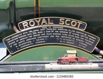 HAWORTH, ENGLAND, JUNE 26 2018 The nameplate of Former London Midland and Scottish Railway steam locomotive 46100 Royal Scot at Haworth on The Keighley and Worth Valley Railway, England.