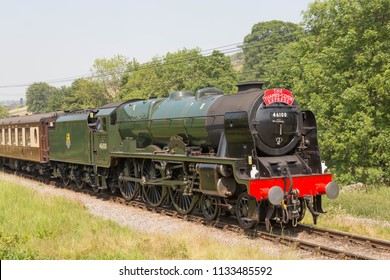 HAWORTH, ENGLAND, JUNE 26 2018 Former London Midland and Scottish Railway steam locomotive 46100 Royal Scot leaving Haworth on The Keighley and Worth Valley Railway, England.