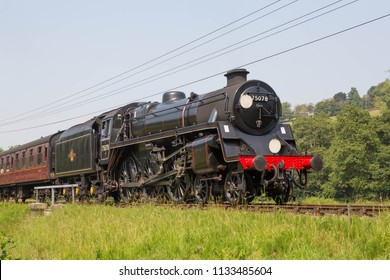 HAWORTH, ENGLAND, JUNE 26 2018 Former British Railways Standard 4MT steam locomotive 75078 leaving Haworth on The Keighley and Worth Valley Railway, England.