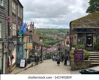 Haworth / UK - June 5 2019: Looking down Main Street in Haworth, Yorkshire