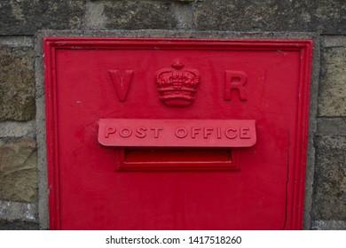 Haworth / UK - June 5 2019: Old victorian wall mounted post box