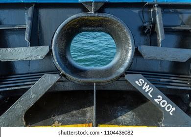 Hawse of a cargo ship.