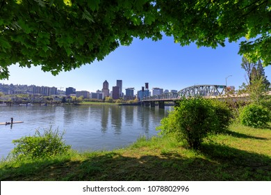 Hawthorne bridge on Willamette river with cityscape and skyline in portland