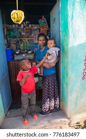 Hawzen, Tigray, Ethiopia 11/26/2017 Ethiopian woman and her children at her little grocery store.