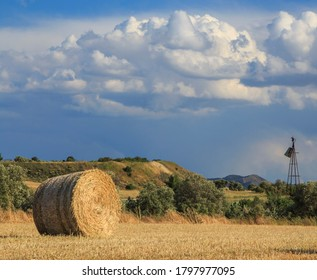 Hay Bales With Blue Sky And Fluffy Cloud