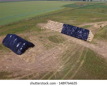 Hay bales in the countryside for winter. Aerial view.