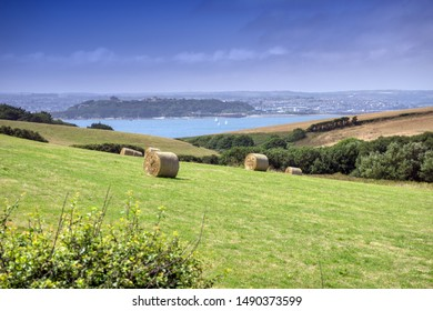 Hay Bales in Field near St Anthony Head, Roseland Peninsula, Cornwall UK, Falmouth and Pendennis Castle in the Bakcground