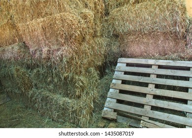 hay in a barn pallet farm agriculture storage background
