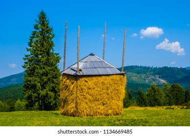 haystack among a green rural fields