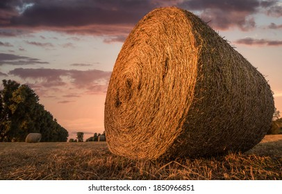 Haystack on farm field in morning. Haystack. Haystack farm field. Haystack view