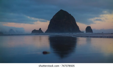 Haystack Rock at Cannon Beach with the sun setting