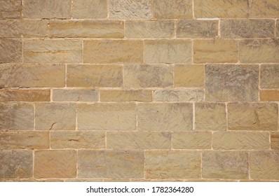 Haywards Heath / UK - May 30, 2020: A sandstone wall from a church, shot at eye-level