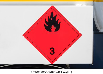 "Hazard label ""Flammable liquids 3 - Flame Black"" on a truck"