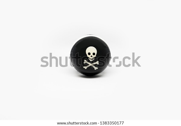 Hazard skull or Poison warning icon on the plastic ball, which is the common sign of chemical hazardous. Object on white isolated background photo.
