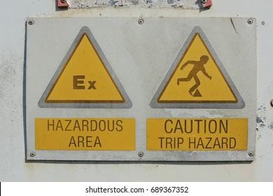 HAZARDOUS AREA - CAUTION TRIP HAZARD - signs in Portwrinkle, near Looe in Cornwall